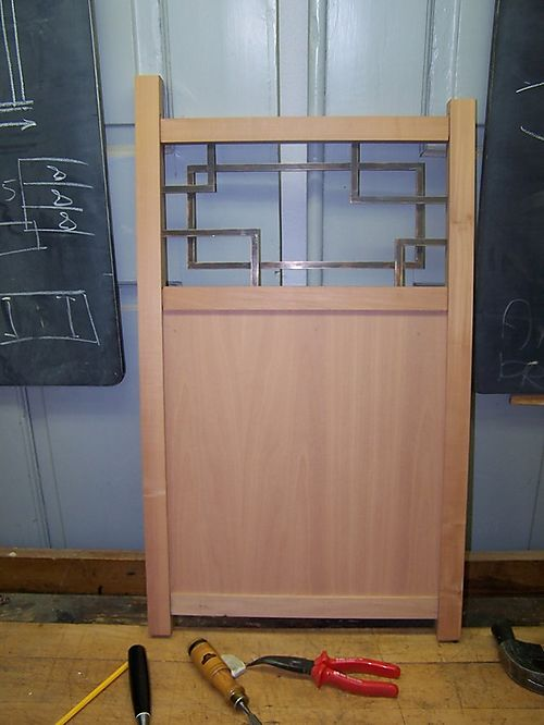 Brass work in place in one of the side panels