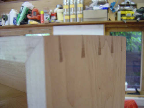 Hand cut mitred dovetail contruction (doors and cabinet)